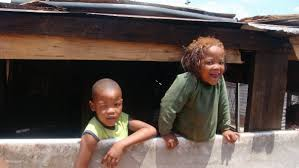 Happy kids who don't have a lot of material possessions
